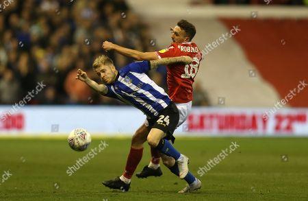 Sheffield Wednesday's Ashley Baker battles with Nottingham Forest's Jack Robinson