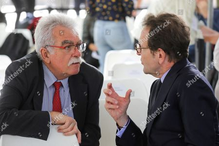 President of the La Republique en Marche (LREM) parliamentary group Gilles Le Gendre (R) speaks with French communist Member of Parliament Andre Chassaigne (L) as they attend a national ceremony to pay tribute to the victims of terrorism, in Paris, France, on September 19, 2018.
