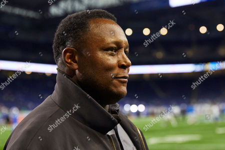 Detroit Lions former Hall of Fame running back Barry Sanders smiles on the sidelines before an NFL football game against the New York Jets in Detroit