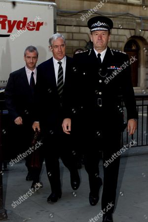 Metropolitian Police Commissioner Sir John Stevens With His Predecessor Sir Paul Condon Leave The City Of London Magistrates Court Today. The Pair Were Jointly Committed To Stand Trial Charged With Safety Breaches After Police Officers Fell Through Roofs Whilst Chasing Suspects.metropolitian Police Commissioner Sir John Stevens With His Predecessor Sir Paul Condonat The City Of London Magistrates Court Today