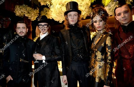Alexander Vlahos, Asa Butterfield and Joshua Kane with models during presentation
