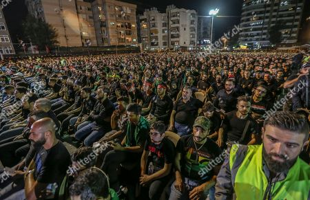 Supporters of Hezbollah listen to Hezbollah Secretary General Sayyed Hassan Nasrallah delivers a speech via a video link, during the night of the tenth of Muharram, the last night of 'Ashura' in the southern suburb of Beirut, Lebanon, 19 September 2018. Hassan Nasrallah addressed a number of political issues in Lebanon and the Arabic countries. Shiite Muslims across the world are observing Muharram, the first month of the Islamic calendar. The climax of Muharram is the Ashura festival commemorating the martyrdom of Imam Hussein, a grandson of the Prophet Mohammed in the Iraqi city of Karbala in the seventh century.