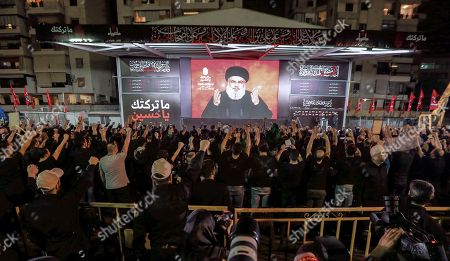 Supporters watch as Hezbollah Secretary General Sayyed Hassan Nasrallah (C) delivers a speech via a video link, during the night of the tenth of Muharram, the last night of 'Ashura' in the southern suburb of Beirut, Lebanon, 19 September 2018. Hassan Nasrallah addressed a number of political issues in Lebanon and the Arabic countries. Shiite Muslims across the world are observing Muharram, the first month of the Islamic calendar. The climax of Muharram is the Ashura festival commemorating the martyrdom of Imam Hussein, a grandson of the Prophet Mohammed in the Iraqi city of Karbala in the seventh century.