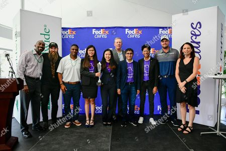 MyCryptoHippo from JA of Central Ontario with panel judges Warrick Dunn (3x Pro Bowler and Atlanta Falcons Ring of Honor member), Marc Leishman (3x PGA TOUR tournament winner), David Cunningham (President and CEO of FedEx Express) and Ryan Lane (Owner of Dream Beard and FedEx Small Business Grant Recipient) after claiming their title at the FedEx Junior Business Challenge finals on in Atlanta. The panel selected the group to win this season's FedEx Junior Business Challenge and generate a $75,000 donation from FedEx to their local JA Chapter