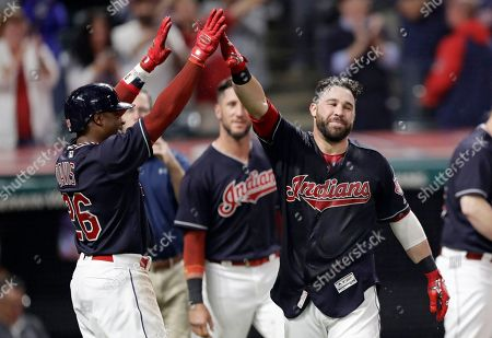 Jason Kipnis, Rajai Davis. Cleveland Indians' Jason Kipnis, right, celebrates with Rajai Davis after Kipnis hit a game-winning grand slam in the ninth inning of a baseball game against the Chicago White Sox, in Cleveland. The Indians won 4-1