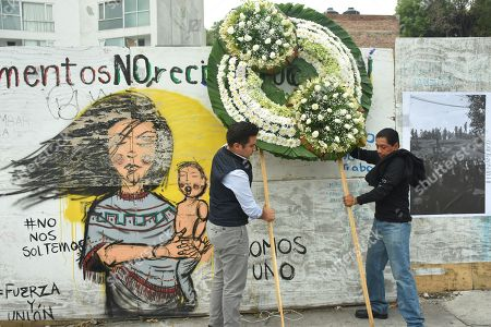 Relatives of the victims of the 7.1 magnitude earthquake of September 19, 2017 who lost their lives perform a ceremony and minute of silence for all the people who died in the earthquake outside the building of Alvaro Obregon 286, Colonia Condesa.