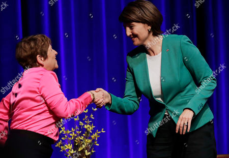 U.S. Rep. Cathy McMorris Rodgers, R-Spokane, right, shakes hands with Lisa Brown, left, her Democratic challenger, following a debate, in Spokane, Wash