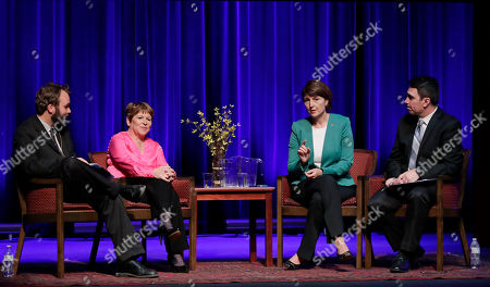 U.S. Rep. Cathy McMorris Rodgers, R-Spokane, second from right, and her Democratic challenger, Lisa Brown, second from left, take part in a debate during a questioning period regarding campaign ads, in Spokane, Wash. The forum was moderated by Kip Hill, left, of the Spokesman-Review newspaper, and Sean Owsley, right, of KHQ-TV