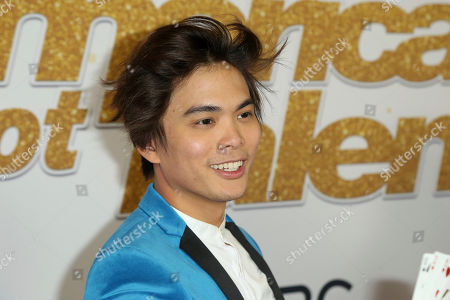 "AGT's winner magician Shin Lim shows his cards as he arrives at the ""America's Got Talent"" Season 13 Finale Show red carpet at the Dolby Theatre, in Los Angeles"