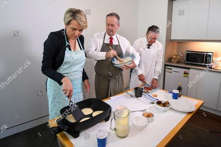 Deputy Opposition Leader Tanya Plibersek (L), Australian Opposition Leader Bill Shorten (C) and shadow Agriculture Minister Joel Fitzgibbon (R) prepare strawberry pancakes, amid ongoing cases of fruit contamination, during a press opportunity at Parliament House in Canberra, Australia, 20 September 2018.