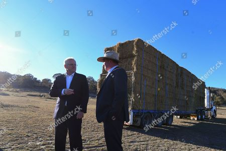 Australian Prime Minister Scott Morrison (L) and drought envoy Barnaby Joyce (R) speak during an event to announce the government's drought response at Royalla, New South Wales, Australia, 20 September 2018. The Australian state of New South Wales was declared as 100 percent drought affected by the government in August 2018.