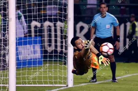 Stock Image of Camilo Vargas, goalkeeper of Colombia's Deportivo Cali, blocks a penalty shot by Ecuador's Liga de Quito during a Copa Sudamericana soccer match in Cali, Colombia, . Deportivo Cali won 3-1 on penalty kicks and qualified for the semifinals