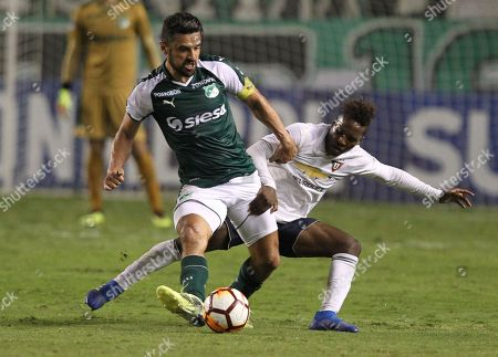Stock Picture of Cali's Andres Perez (L) vies for the ball with Liga de Quito's Jhojan Julio (R) during a Copa Sudamericana game between Deportivo Cali and Liga de Quito at the Palmaseca Monumental Stadium of Cali, Valle del Cauca, Colombia, 19 September 2018.