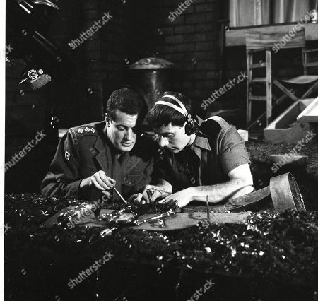 Residents of Coronation Street are evacuated when an unexpoded wartime bomb is discovered in Albert Tatlock's yard. John Quayle (as Captain Platt) and Duncan Livingstone (as Corporal Dixon)