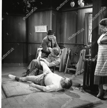 Stan Ogden trains for his wrestling match. Patrick McAlinney (as Tickler Murphy), Peter Adamson (as Len Fairclough), Bernard Youens (as Stan Ogden) and Violet Carson (as Ena Sharples)