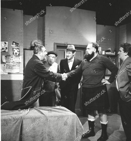 Stan Ogden takes on Ian Campbell in a wrestling match. Bernard Youens (as Stan Ogden), Patrick McAlinney (as Tickler Murphy), Gordon Rollings (as Charlie Moffitt), Ian Campbell and Peter Adamson (as Len Fairclough)