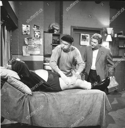 Stan Ogden takes on Ian Campbell in a wrestling match. Bernard Youens (as Stan Ogden), Patrick McAlinney (as Tickler Murphy) and Peter Adamson (as Len Fairclough)