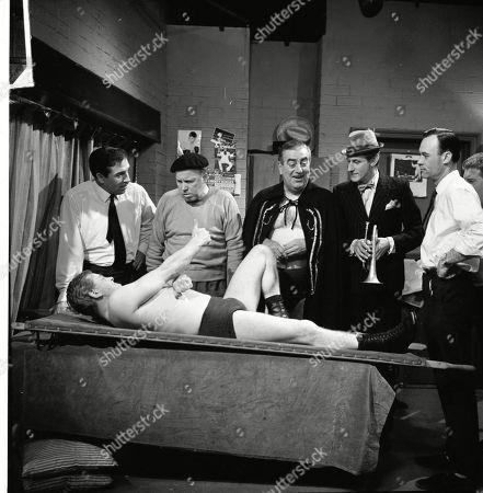 Stan Ogden takes on Ian Campbell in a wrestling match. Terry Nylands, Patrick McAlinney (as Tickler Murphy), Bernard Youens (as Stan Ogden) and Gordon Rollings (as Charlie Moffitt)