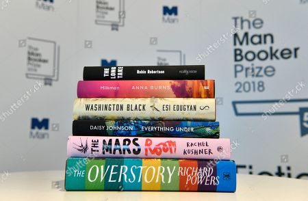 Nominated books are seen at a photocall for the shortlist for the Man Booker Prize 2018 in London, Britain, 20 September 2018. The shortlist comprises Milkman by Anna Burns, Washington Black by Esi Edugyan, Everything Under by Daisy Johnson, The Mars Room by Rachel Kushner, The Overstory by Richard Powers and The Long Take by Robin Robertson.
