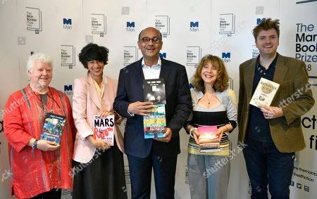Judges Kwame Anthony Appiah (C), Val McDermid (L), Leo Robson (R), Jacqueline Rose (2-L) and Leanne Shapton (2-R) hold nominated books at a photo-call for the shortlist for the Man Booker Prize 2018 in London, Britain, 20 September 2018. The shortlist comprises Milkman by Anna Burns, Washington Black by Esi Edugyan, Everything Under by Daisy Johnson, The Mars Room by Rachel Kushner, The Overstory by Richard Powers and The Long Take by Robin Robertson.