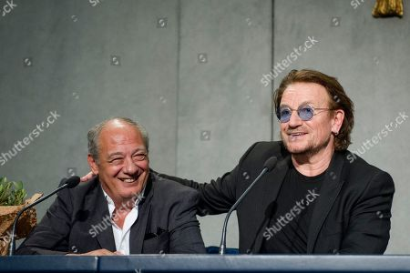 Jose Maria Del Corral, Global Head of Scholas Occurrentes Foundation, Bono Vox (Paul David Hewson), frontman of rock band U2 during a press conference after the meeting with Pope Francis press conference after meeting Pope Francis