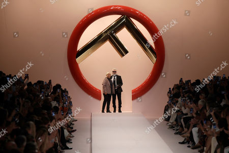 Silvia Venturini Fendi, Karl Lagerfeld. Designers Silvia Venturini Fendi, left, and Karl Lagerfeld accept applause at the end of Fendi 's women's 2019 Spring-Summer collection, unveiled during the Fashion Week in Milan, Italy