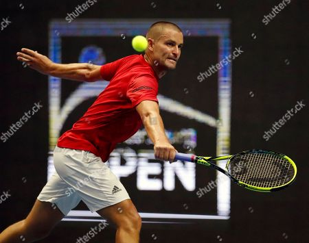 Mikhail Youzhny of Russia in action against Roberto Bautista Agut of Spain during their second round match of the St.Petersburg Open ATP tennis tournament in St.Petersburg, Russia, 20 September 2018.