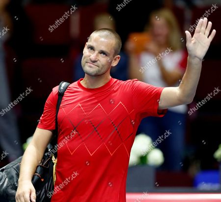 Mikhail Youzhny of Russia reacts after his match against Roberto Bautista Agut of Spain during their second round of the St.Petersburg Open ATP tennis tournament in St.Petersburg, Russia, 20 September 2018.