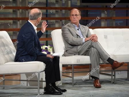 Andy Serwer, Larry Fink. BlackRock CEO Larry Fink, right, talks with Yahoo Finance editor-in-chief Andy Serwer during the Yahoo Finance All Markets Summit: A World of Change at The TimesCenter, in New York
