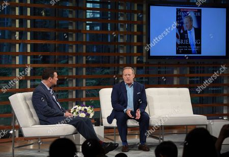 Stock Image of Rick Newman, Sean Spicer. Former White House Press Secretary Sean Spicer, right, talks with journalist Rick Newman during the Yahoo Finance All Markets Summit: A World of Change at The TimesCenter, in New York