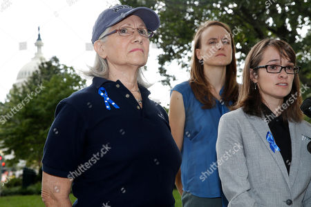Alexis Goldstein, Karen Bralove, Sarah Burgess. Alumni of Holton-Arms School, Karen Bralove, class of 1963, left, Sarah Burgess, class of 2005, and Alexis Goldstein, class of 1999, speak to members of the media about a letter they delivered to the office of Sen. Shelley Moore Capito, R-W.Va., who is also an alumni of the school, on Capitol Hill in Washington. The letter, which the group wants Capito to sign, calls for an independent investigation of accusations by Christine Blasey Ford, a 1984 alumni of the school, against Supreme Court nominee Brett Kavanaugh