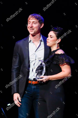 Ashley Gorley,Jennifer Turnbow. Ashley Gorley, left, accepts the Songwriter of the Year award from Jennifer Turnbow at the 2018 Nashville Songwriters Awards at Ryman Auditorium, in Nashville, Tenn