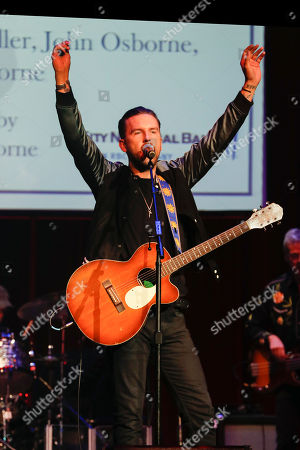 T. J. Osborne of Brothers Osborne performs at the 2018 Nashville Songwriters Awards at Ryman Auditorium, in Nashville, Tenn