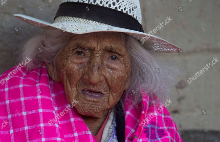 Julia Flores Colque, 117, a native Quechua sits outside her home in Sacaba, Bolivia. Her national identity card says Flores Colque was born on Oct. 26, 1900 in a mining camp in the Bolivian mountains. At 117 and just over 10 months, she would be the oldest woman in the Andean nation and perhaps the oldest living person in the world