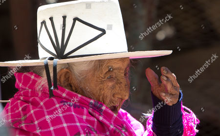 Julia Flores Colque, 117, sits outside her home in Sacaba, Bolivia. Her national identity card says Flores Colque was born on Oct. 26, 1900 in a mining camp in the Bolivian mountains. At 117 and just over 10 months, she would be the oldest woman in the Andean nation and perhaps the oldest living person in the world