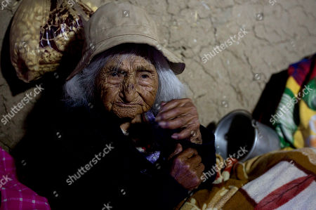 117-year-old Julia Flores Colque sits inside her home in Sacaba, Bolivia. The previously world's oldest person, a 117-year-old Japanese woman, died earlier this year. Her passing apparently left Flores Colque as the world's oldest living person