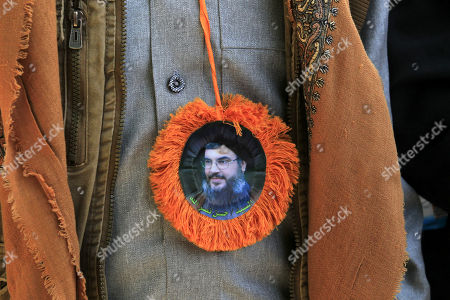 A pro-Houthi Shiite Muslim wears a medal with a picture of Hezbollah leader Sayed Hassan Nasrallah during Ashura Day procession in Sana'a, Yemen, 20 September 2018. Shiite Muslims across the world are observing Muharram, the first month of the Islamic calendar. The climax of Muharram is the Ashura festival commemorating the martyrdom of Imam Hussein, a grandson of the Prophet Muhammad in the Iraqi city of Karbala in the seventh century.