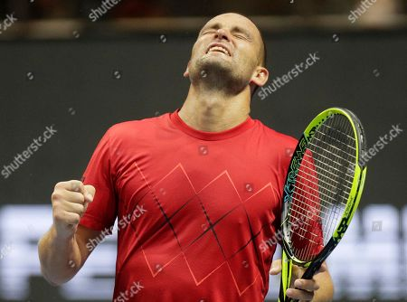Mikhail Youzhny of Russia reacts during the St. Petersburg Open ATP tennis tournament match against Roberto Bautista of Spain in St. Petersburg, Russia