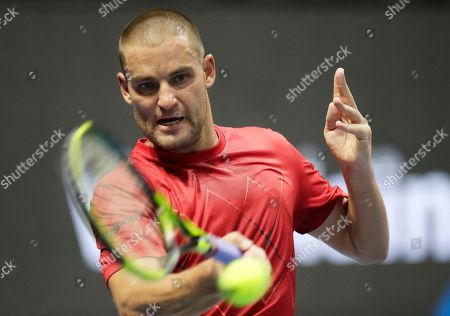 Mikhail Youzhny of Russia returns the ball to Roberto Bautista of Spain during the St. Petersburg Open ATP tennis tournament match in St. Petersburg, Russia
