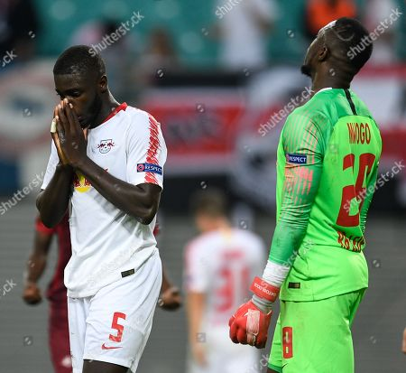 Leipzig's Dayot Upamecano (L) and Leipzig's goalkeeper Yvon Mvogo show their dejection after the UEFA Europa League Group B soccer match between RB Leipzig and FC Salzburg in Leipzig, Germany, 20 September 2018.