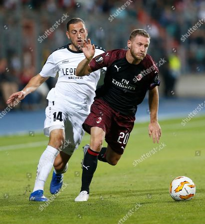 Dudelange's Couturier Clement (L) and Milan's Ignazio Abate (R) fight for the ball during the UEFA Europa League group stage soccer match between F91 Dudelange and AC Milan at Josy Barthel stadium in Luxembourg, 20 September 2018.