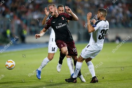 Milan's Ignazio Abate (L) and Dudelange's Aniss El Hriti (R) fight for the ball during the UEFA Europa League group stage soccer match between F91 Dudelange and AC Milan at Josy Barthel stadium in Luxembourg, 20 September 2018.