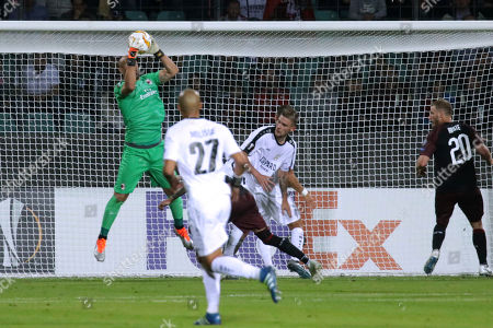 Milan's goalkeeper Pepe Reina saves during a Group F Europa League soccer match between F91 Dudelange and AC Milan at the Josey Barthel stadium in Dudelange, Luxembourg