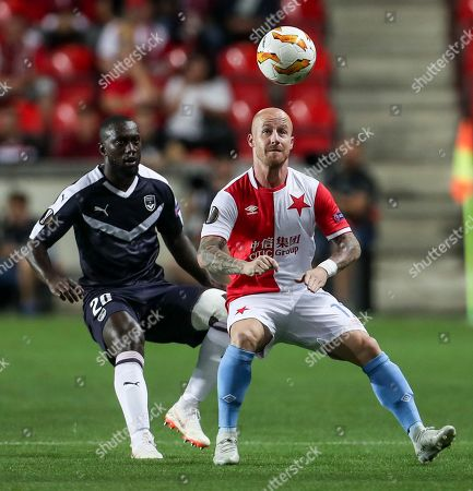 Slavia Prague's Miroslav Stoch (R) in action against Bordeaux's Youssouf Sabaly (L) during the UEFA Europa League group C soccer match between Slavia Prague and Girondins Bordeaux in Prague, Czech Republic, 20 September 2018.