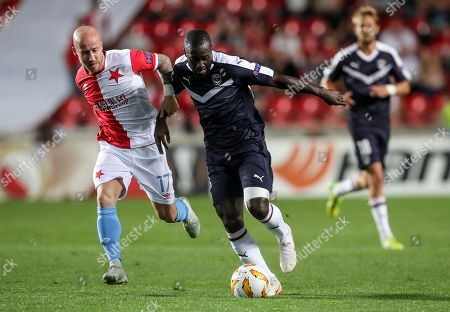 Slavia Prague's Miroslav Stoch (L) in action against Bordeaux's Youssouf Sabaly (R) during the UEFA Europa League group C soccer match between Slavia Prague and Girondins Bordeaux in Prague, Czech Republic, 20 September 2018.