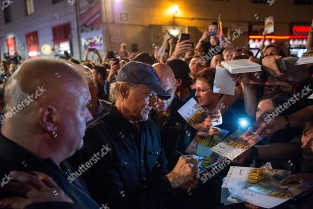 Italian actor and director Terence Hill (C) signs autographs to fans as he arrives for the Hungarian premiere of his film 'My Name Is Thomas' in Budapest, Hungary, 20 September 2018.