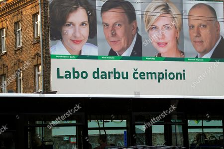 Stock Image of Candidates from the Union of Greens and Farmers, Minister of Finance Dana Reizniece - Ozola (L-R), Prime Minister Maris Kucinskis, Minister for Health Anda Caksa and Minister of Defence Raimonds Bergmanis on a pre-election poster 'Champions of Good Jobs', during election campaign in Riga, Latvia, 20 September 2018. Latvia will hold the 13th parliamentary elections on 06 October 2018.