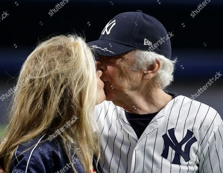 Stock Picture of Designer Ralph Lauren, right, kisses his wife, Ricky Anne Loew-Beer, before throwing out the ceremonial first pitch prior to a baseball game between the Boston Red Sox and the New York Yankees, in New York