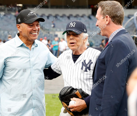 US fashion designer Ralph Lauren (C) shakes hands with former New York Yankees Baseball Hall Of Famer Reggie Jackson (L) and former New York Yankees pitcher David Cone (R) on the field before the start of the Boston Red Sox vs New York Yankees game at Yankee Stadium in New York, New York, USA, 20 September 2018. He will throw out the ceremonial first pitch.