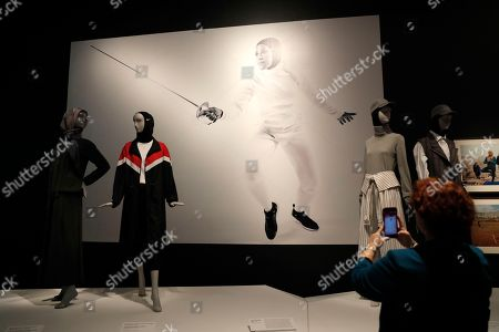 A portrait of fencer Ibtihaj Muhammad for Nike Pro Hijab 2017 by Rick Guest, during the press preview of 'Contemporary Muslim Fashions' exhibit at the de Young Museum in San Francisco's Golden Gate Park in San Francisco, California, USA, 20 September 2018. It's the first major museum exhibition to explore the complex, diverse nature of Muslim dress codes worldwide from high-end style, sportswear, and custom one-of-a-kin looks from different religious interpretations and cultures from both emerging and established designers. The exhibit is on display from 22 September 2018 through 06 January 2019.